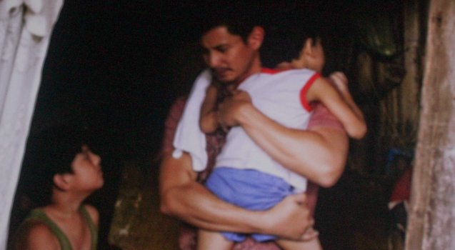 left: Albert Silos (Nilo) helps out AJ Dee (Maryo) carrying sick Bunso. TURO TURO is part of the MMFF New Wave competition showing from Dec 18-24, 2015.