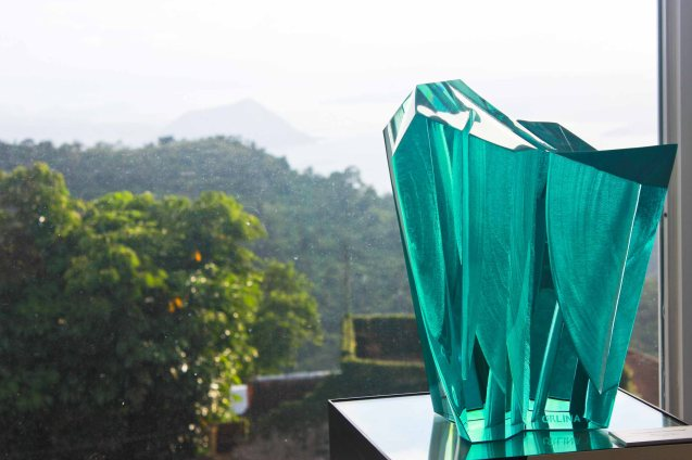 TRIUMPHANT HARMONY (40 x 33 x 23cm) Carved Green glass 2011- this work is juxtaposed with Taal volcano in the background. This is one of many works in Museo Orlina. Photo by Jude Bautista