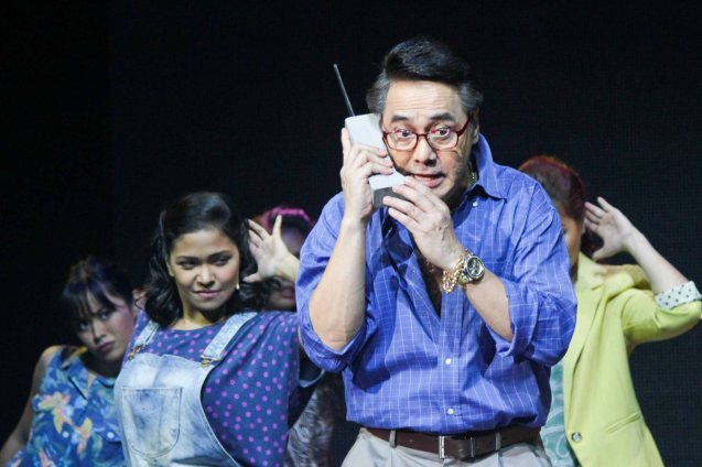 Raymund Concepcion II (Larry) on giant cell phone. BITUING WALANG NINGNING is running at the Newport Performing Arts Theater, Resorts World Manila until January 31, 2016. Photo by Jude Bautista