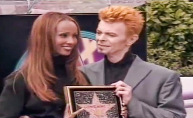 David receives walk of fame star with love of his life, Iman (1997).