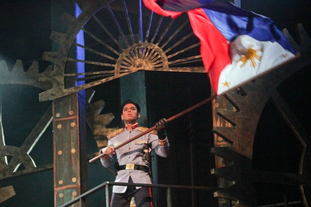 Arman Ferrer (Pres. Emilio Aguinaldo) waves the Philippine Flag as declaration of our independence. TP's MABINING MANDIRIGMA is running from February 19 to March 13, 2016 at the Tanghalang Aurelio Tolentino , CCP with shows at 3pm and 8 pm. Photo by Jude Bautista
