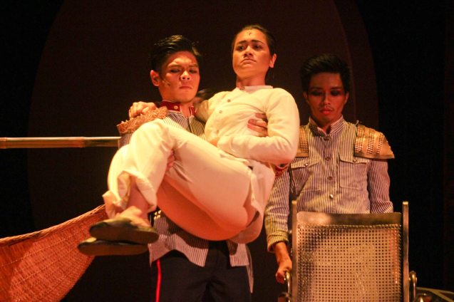 Arman Ferrer (Pres. Emilio Aguinaldo) carries his friend and adviser Delphine Buencamino (Apolinario Mabini). TP's MABINING MANDIRIGMA is running from February 19 to March 13, 2016 at the Tanghalang Aurelio Tolentino , CCP with shows at 3pm and 8 pm. Photo by Jude Bautista