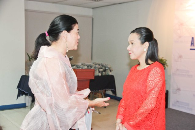 from left: PDI Pres. & CEO Sandy Prieto-Romualdez with Senator Grace Poe. The 5th Indie Bravo was held at the PDI office, Dec. 11, 2014. Photo by Jude Bautista