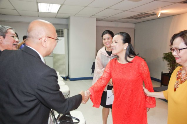 Sen Grace Poe shakes the hand of Phil. Film Export Service Office Exec Dir. Jose Miguel Dela Rosa and FDCP Exec Dir Teddy Granados. The 5th Indie Bravo was held at the PDI office, Dec. 11, 2014. Photo by Jude Bautista