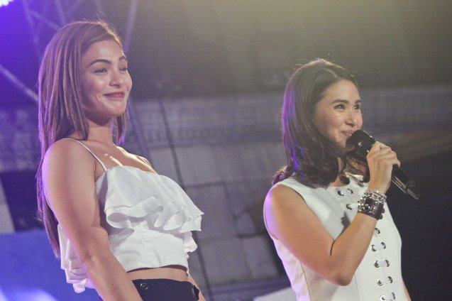 from left: Lovi Poe & Heart Evangelista; The Partido Galing at Puso Miting De Avance was held at Plaza Miranda, Quiapo, Manila last May 7, 2016. Photo by Jude Bautista