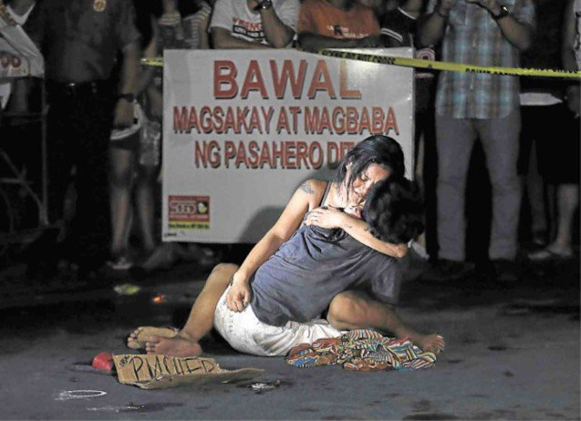 PDI front page: LAMENTATION A weeping Jennelyn Olaires hugs partner Michael Siaron, 30, a pedicab driver and alleged drug pusher, who was shot and killed by motorcycle-riding gunmen near Pasay Rotonda on Edsa. He was one of six killed in drug-related incidents in Pasay and Manila yesterday. RAFFY LERMA/INQUIRER FILE PHOTO photo from http://newsinfo.inquirer.net/799260/duterte-on-photo-of-wife-cradling-slain-drug-pusher-nagda-dramahan-tayo#ixzz4IXeYY6Bc  Follow us: @inquirerdotnet on Twitter | inquirerdotnet on Facebook