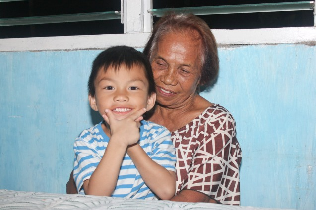 Nana Tely with her favorite apo Iggy; Claveria, Burias-May 18, 2015. Photo by Jude Bautista