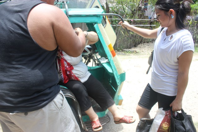That's Raf raf helping my mom alight from a tricycle Burias Island-May 17, 2015. Photo by Jude Bautista