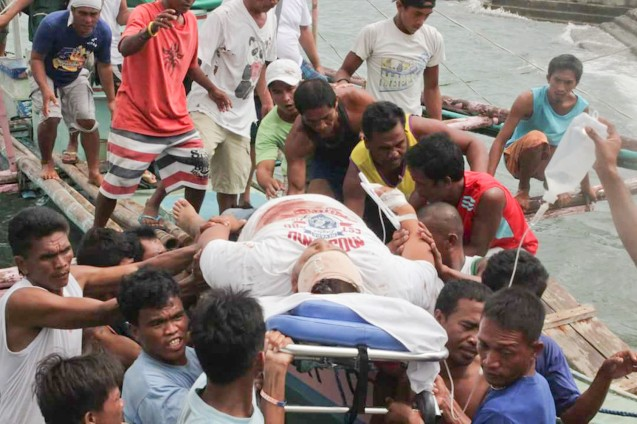 Raf raf Gueta on stretcher after he was shot August 25, 2016 on a boat coming from Claveria, Burias. - from fb pic.